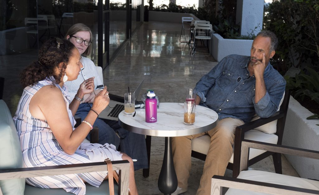 Maria, Gabi and friend of Lynn Manning's actor Roger Guenveur Smith, meet around a table outside at the London West Hollywood Hotel