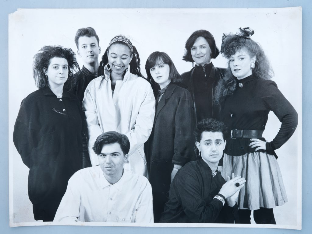 Choc - Group shot of cast of the 80's including a young Maria smiling.