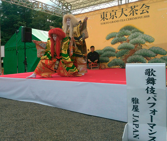 Kabuki dancers performing on an outdoor stage